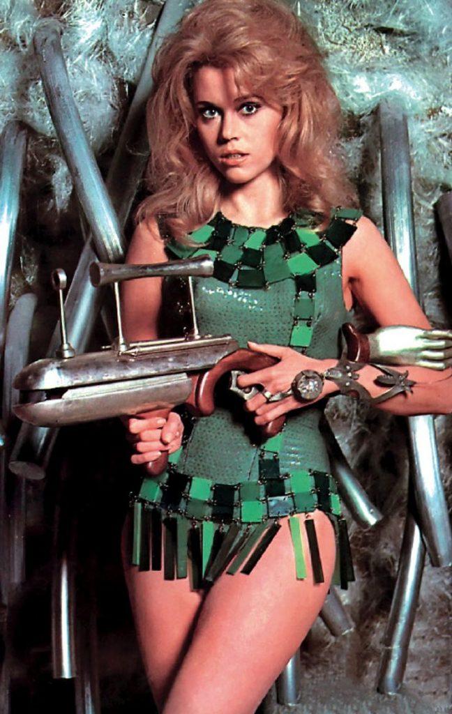 Jane Fonda as Barbarella in green mini dress with ray gun.