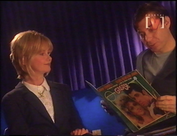 Maynard reads from the book of Grease to Olivia Newton John 1999 Foxtel